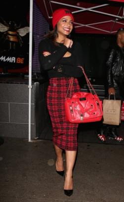 Christina-Milian-went-bold-in-a-red-and-black-check-midi-skirt-with-a-statement-Moschino-bag.--429x700
