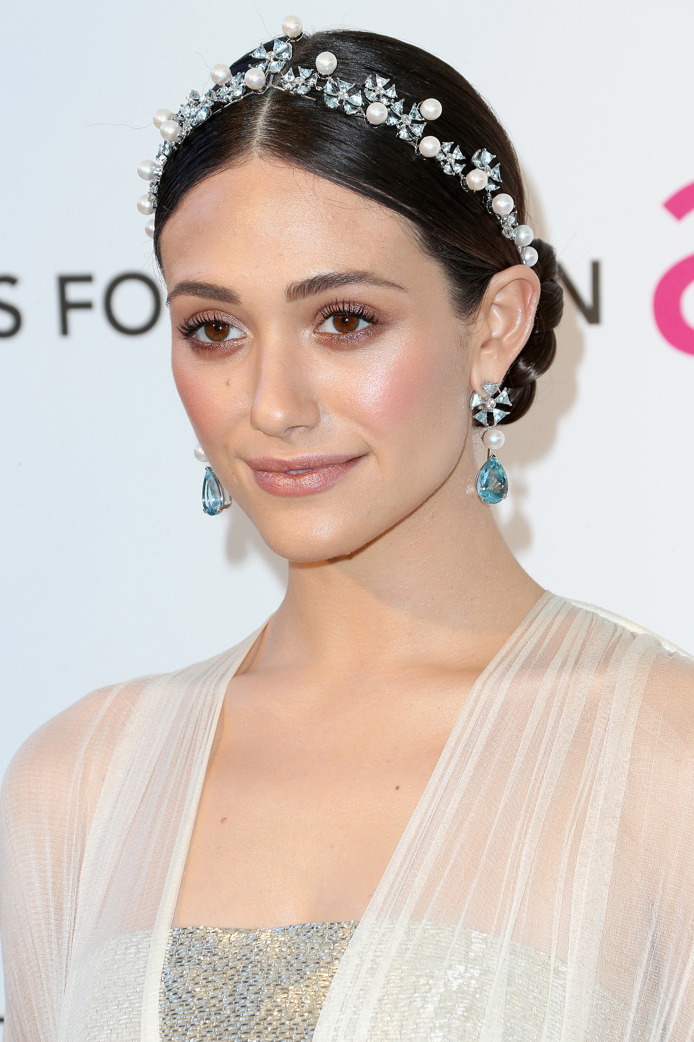 Emmy-Rossum-took-simple-centre-parted-hairstyle-made