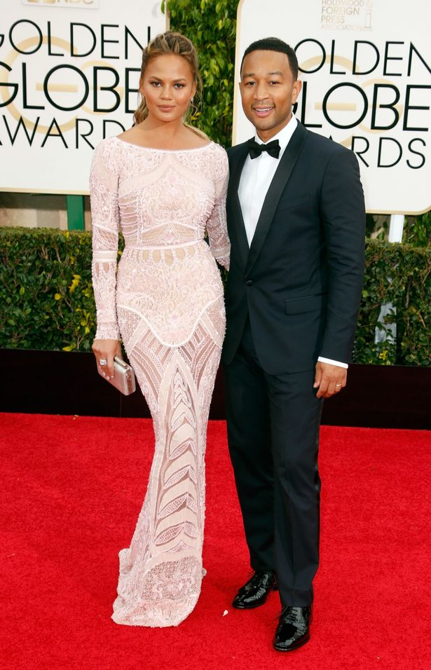 Model-Chrissy-Teigen-L-and-singer-John-Legend-attend-the-72nd-Annual-Golden-Globe-Awards-at-The-Beverly-Hilton-Hotel-on